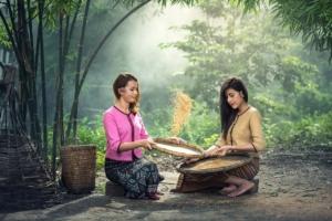 Reis Mädchen getreidemühlen info